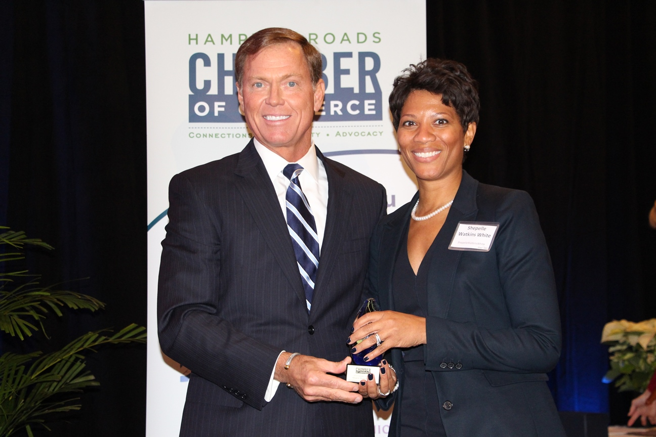 Chamber President & CEO Bryan K. Stephens presents Shepelle Watkins-White with the 2014 Volunteer of the Year Award