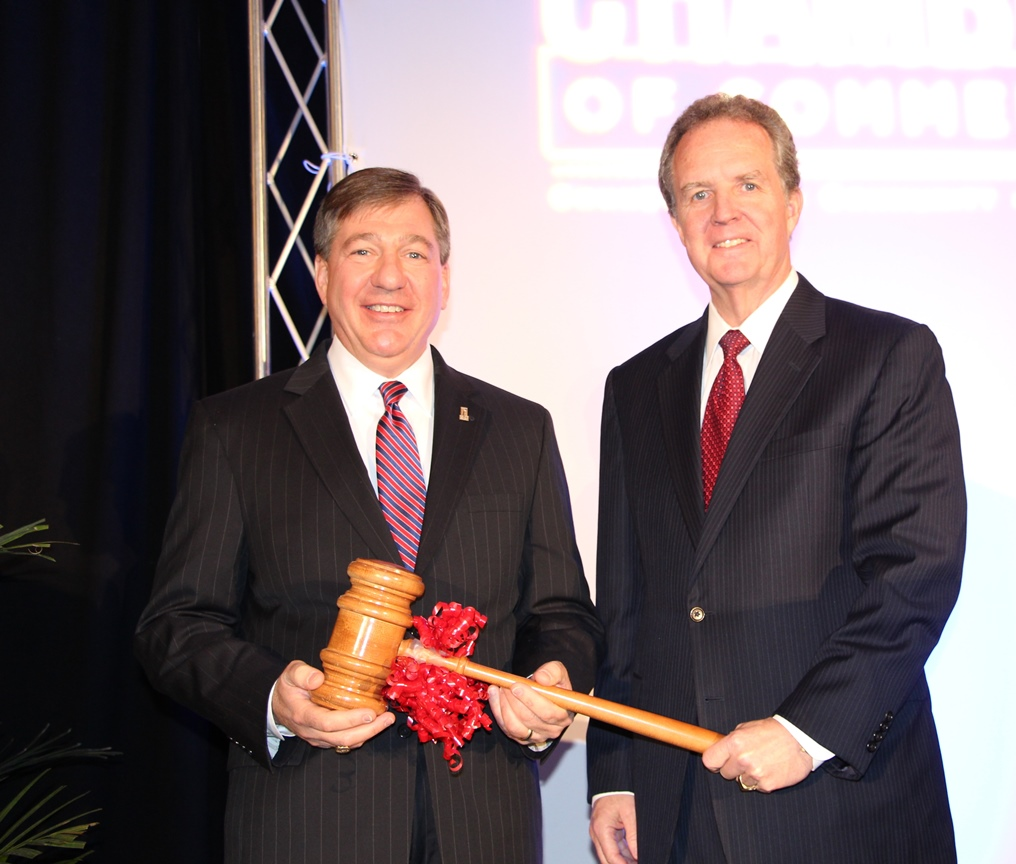 2014 Chair Michael Dudley (right) passes the ceremonial gavel to 2015 Chair Joe Witt
