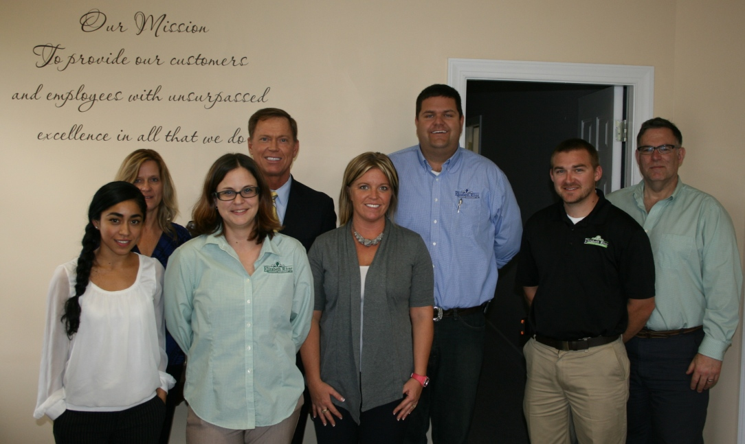 Staff of Elizabeth River Landscape Management, Inc. in Suffolk with Chamber President & CEO Bryan K. Stephens