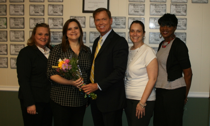 Staff of Home Instead Senior Care in Newport News with Chamber President & CEO Bryan K. Stephens