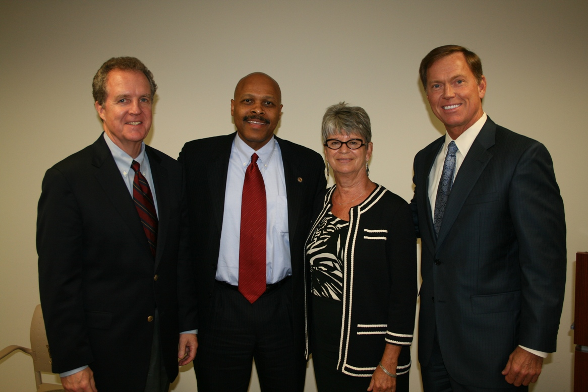 (from left) Chamber Chair Michael Dudley; Secretary Jones; Chamber's Immediate Past Chair Deborah Stearns; Chamber President & CEO Bryan K. Stephens