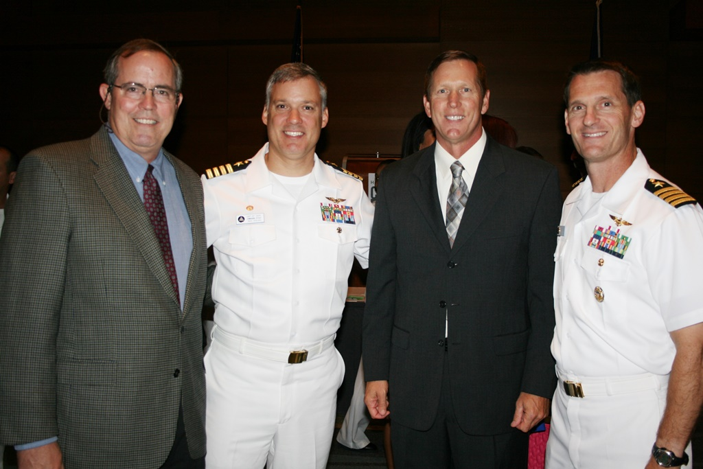 (from left)  Tim Dorsey, Vice President and General Counsel, USA Discounters; Captain Christopher Chope, Commanding Officer of NAS Oceana; Len Santivasci, Director of Military Affairs, USA Discounters; and Captain Lou Shager, Executive Officer, NAS Oceana
