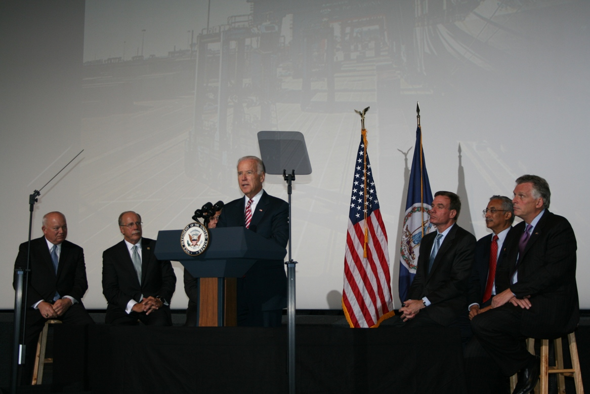 (from left) Norfolk Mayor Paul Fraim; John Reinhart, CEO and Executive Director of the Virginia Port Authority; U.S. Dept. of Transportation Maritime Administrator Paul Jaenichen; Vice President Joe Biden (at podium); Senator Mark Warner; U.S. Rep. Bobby Scott and Governor Terry McAuliffe