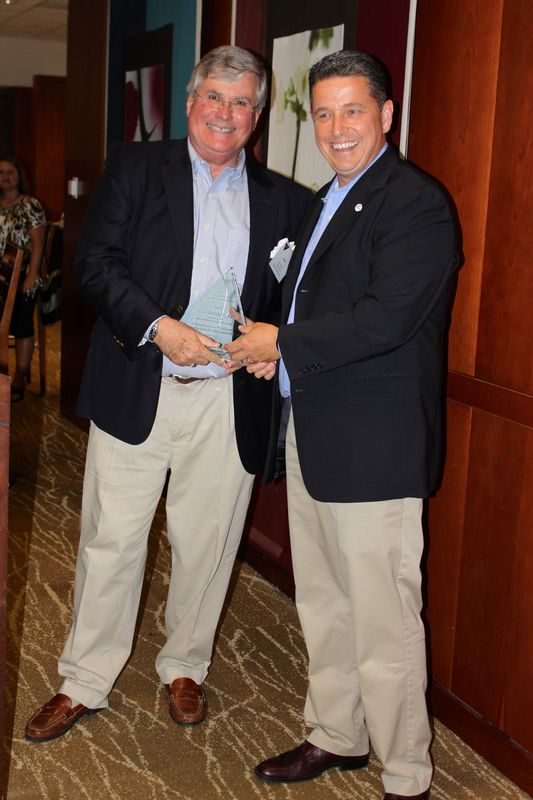 (from left) Jack Hornbeck is presented the lifetime achievement award by Tony Howard, VACCE President and CEO of the Loudon County Chamber of Commerce.