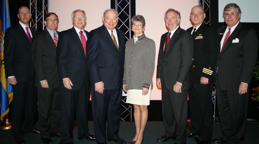 (from left) Grey Persons, the Chamber's Norfolk Division Chair; Michael Kerner of Bon Secours Virginia Health System; John Matson of TowneBank; Norfolk Mayor Paul Fraim; Deborah Stearns, the Chamber's Chair; Jim Hixon of Norfolk Southern; CDR Glen Wood; and Jack Hornbeck, President & CEO of the Chamber