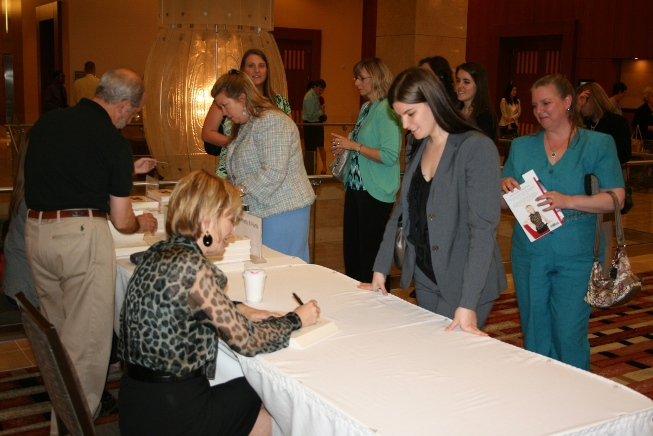 Kate White greeted attendees and signed copies of her book