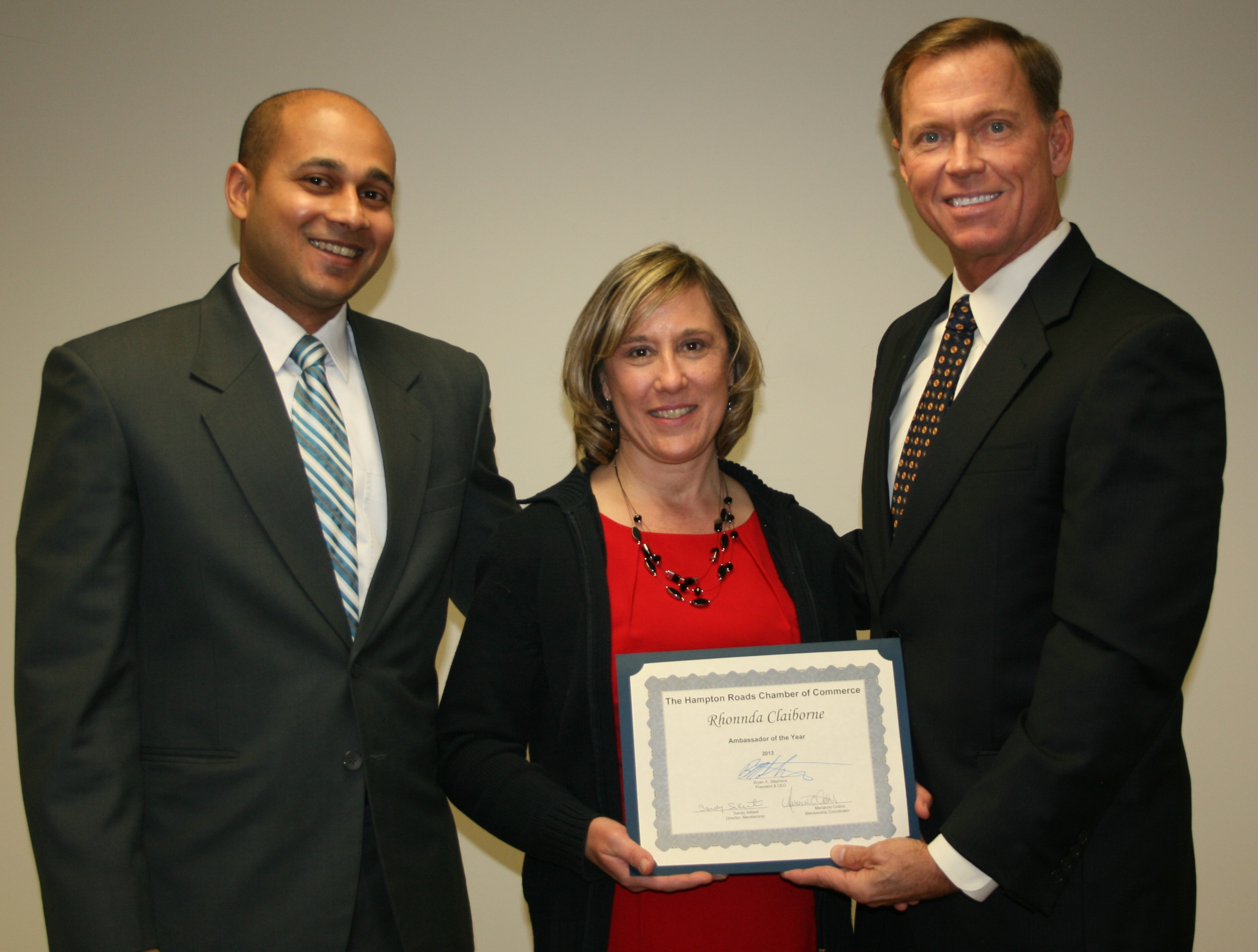"Rhonnda was presented with a certificate and $100 by Chamber President and CEO Bryan Stephens (right) and Neeraj ""Raj"" Agarwal, 2014 Chair of the Ambassador Committee"