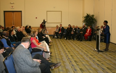 Candidates and attendees listen to Dr. Ella Ward at the Chesapeake City Council forum