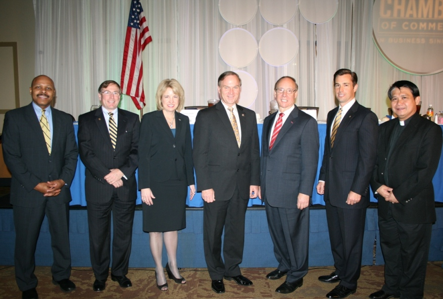 (from left) Maurice Jones (Pilot Media), Chamber's Chair; Michael Kerner, CEO, Bon Secours Hampton Roads; Dawn Glynn, President, TowneBank Chesapeake; Congressman Randy Forbes; Mayor Alan Krasnoff, Patrick Reynolds, Chair of the Chamber's Chesapeake Divsion; Father Romeo Jazmin