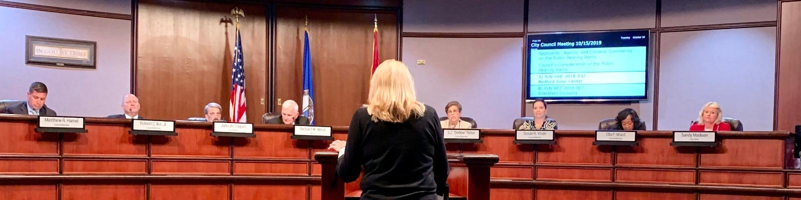 Michele Partridge-Lane, Chesapeake Division Board Chair, addressing the Chesapeake City Council (May 21st meeting) to endorse the Bedford Solar Center. Cover