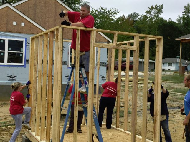 Employees from Bank of America took part in the bank's global build initiative by volunteering with Habitat for Humanity Peninsula & Greater Williamsburg to renovate a home in Williamsburg.