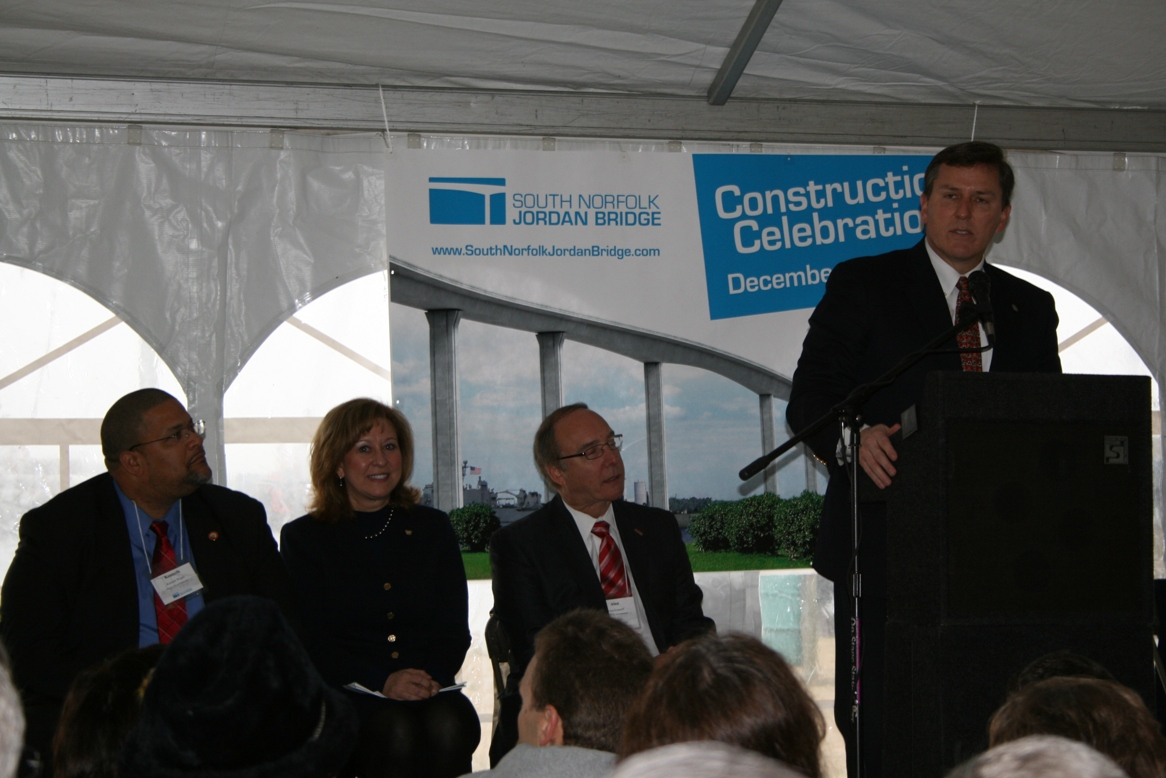 Sean Connaughton, Virginia Secretary of Transportation, addresses the crowd.  Seated (from left) Portsmouth Mayor Kenneth Wright, Linda Figg and Chesapeake Mayor Alan Krasnoff