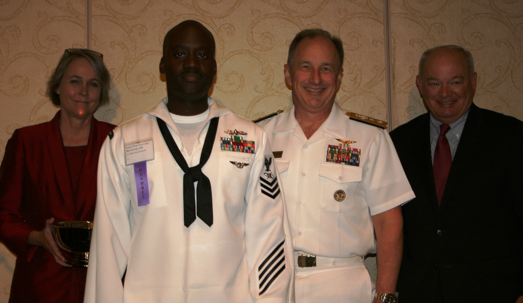 (from left) Mason Andrews, Chair of the Norfolk Division, Hampton Roads Chamber of Commerce; Petty Officer 1st Class Bleu Moore; Rear Admiral Mark Boensel; and Norfolk Mayor Paul Fraim