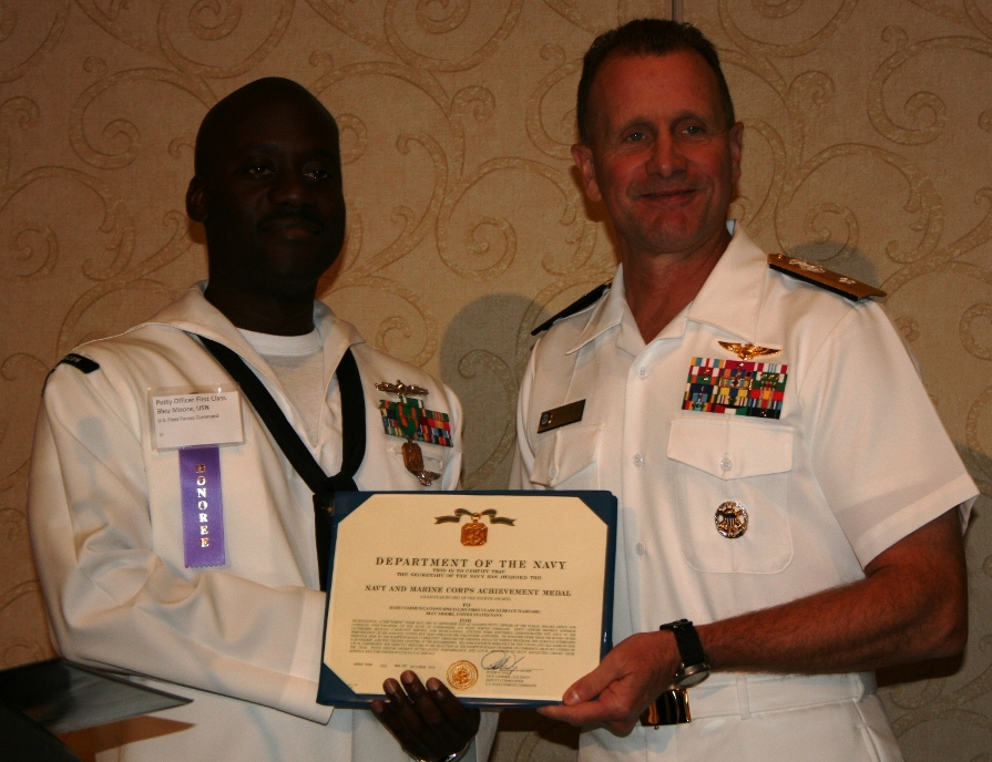 (from left) Petty Officer 1st Class Bleu Moore and Rear Admiral Scott Craig