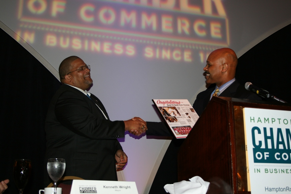 Maurice Jones, President and Publisher of the Virginian-Pilot presenting Mayor Wright with an award