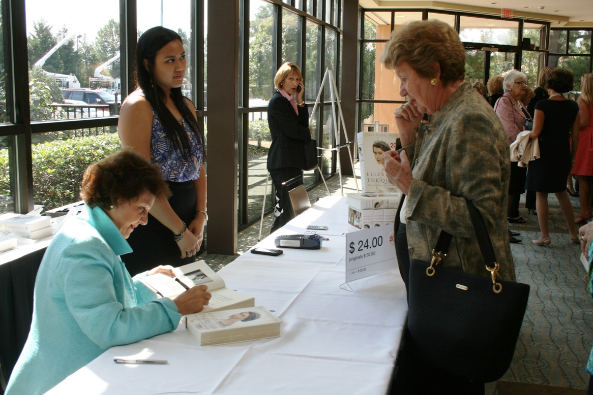 Author Sally Bedell Smith signs a copy of her book