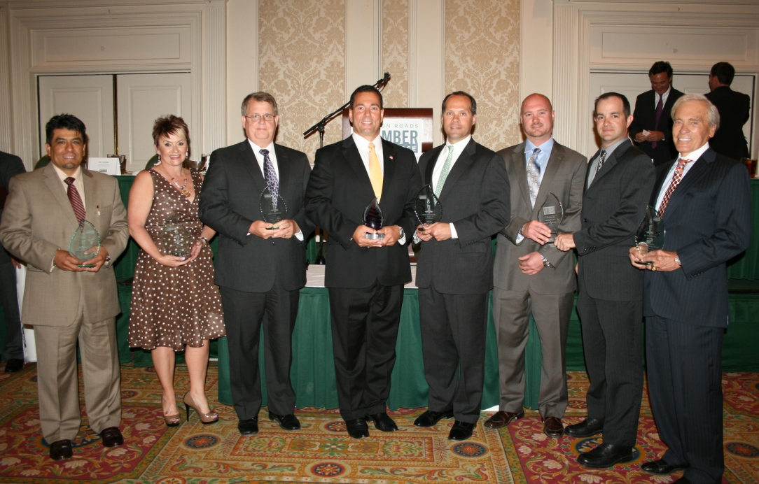 Small Business of the Year Award recipients (from left) Dr. Johnny Garcia of SimIS Inc. (Portsmouth); Rhonda Bunch of Remedies Spa, Salon and Barbershop (Suffolk); David Spanka of the Phoenix Group (Chesapeake); Kevin Kordek of A-Active Termite and Pest Control Co. (Virginia Beach & Regional Winner); Jon Pruden of TASTE (Norfolk); Josh Tawes and Anthony Stile of Accelerated Financial Solutions (Young Entrepreneur Award); and Ramon Breeden Jr. (Impressions in Print Leadership Award)