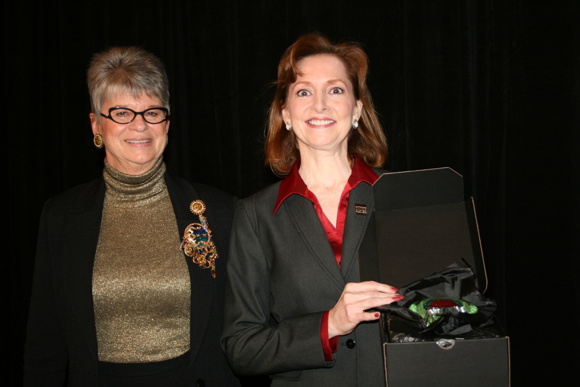 Deborah Stearns presented the Chamber's 2013 Volunteer of the Year Award to Susan Blackman (right)