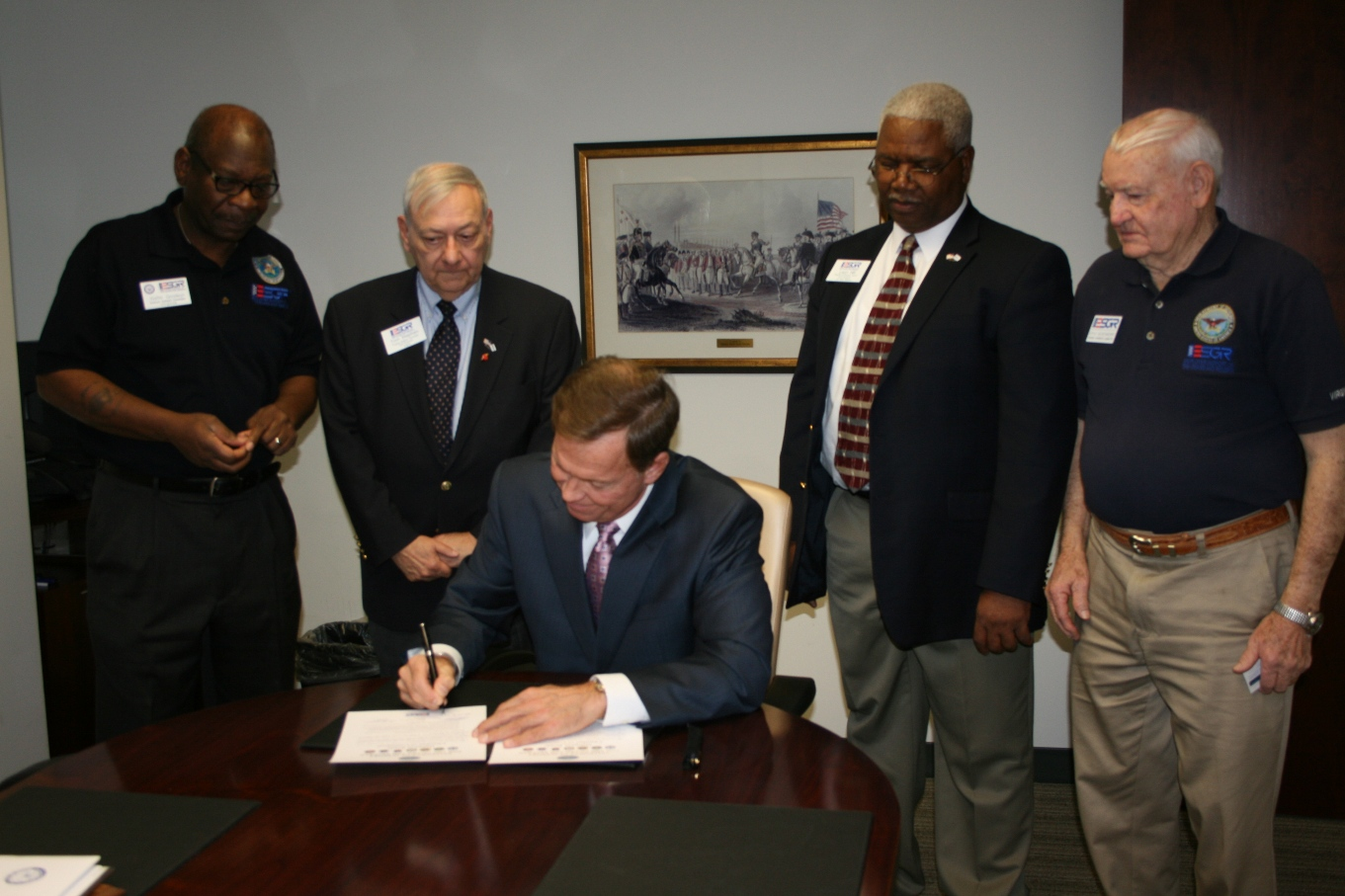 The Chamber's President & CEO Bryan Stephens signs a statement of support as members of ESGR look on (from left) Walter Goodwyn, MGySgt, USMC (Ret.); Thomas Stephen; Leon Hill; and CDR A. Doyle Quisenberry, USNR (Ret.)
