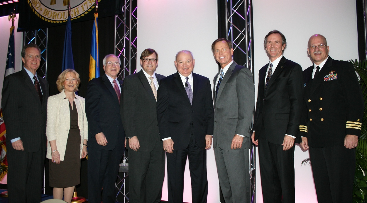 (from left) Michael Dudley, Chamber's Chair; Deborah Butler, Norfolk Southern Corp.; John Matson, TowneBank; John Barrett, Bon Secours Hampton Roads; Mayor Paul Fraim; Bryan Stephens, Chamber's President & CEO; Billy King, Chamber's Norfolk Division Chair; and CDR Denis Cox, Naval Station Norfolk