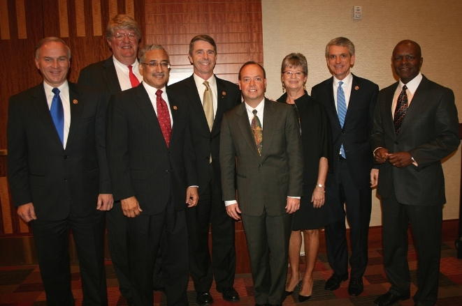 (from left) Congressman Randy Forbes; HRBizPAC Chair Shep Miller; Congressman Bobby Scott; Congressman Rob Wittman; Don Redmond, Portfolio Recovery Associates; Chamber Board Chair Deborah Stearns; Congressman Scott Rigell; and Gary McCollum, Cox Communications