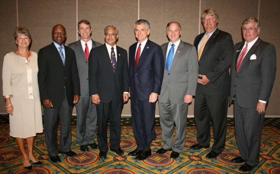( from left ) Deborah Stearns, Chamber Chair; Gary T. McCollum, senior vice president and general manager for Cox; Congressman Rob Wittman, 1st Congressional District; Congressman Bobby Scott, 3rd Congressional District; Congressman Scott Rigell, Second Congressional District; Congressman Randy Forbes, Fourth Congressional District, Shep Miller, Chair Hampton Roads Business Political Action Committee; Jack Hornbeck, President and CEO of the Chamber