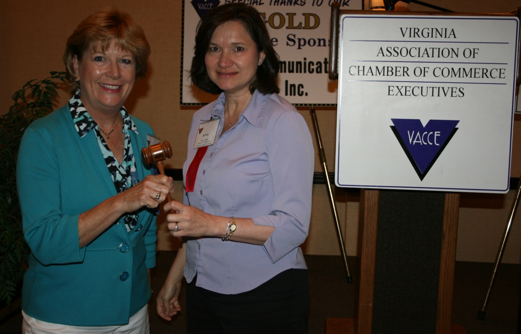 2010-2011 VACCE President Sylvia Haines (right) passes the gavel to incoming President Vicki Gardner