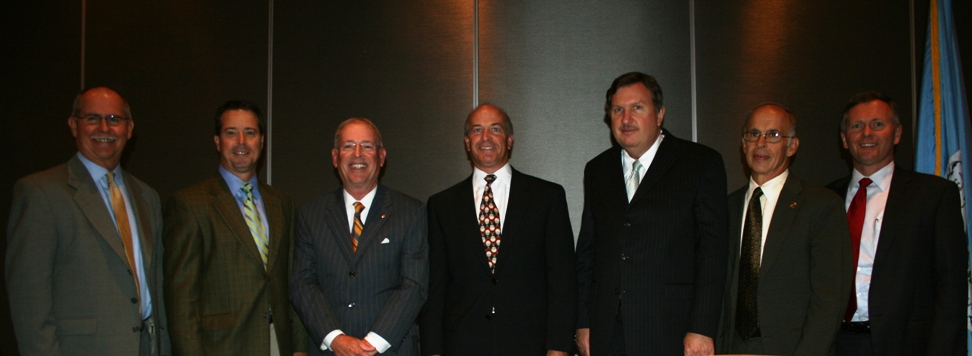 (from left) Dr. James Merrill; Nelson Adcock, Chair, Hampton Roads Chamber of Commerce; Max Bartholomew, Sr. External Affairs Mgr., Dominion; John Wilson, Virginia Beach Divsion Chair, Hampton Roads Chamber of Commerce; Ira Agricola, Sr. VP of Govt. Affairs, Hampton Roads Chamber of Commerce; Dan Edwards, Chair, Virginia Beach School Board; Joseph Bouchard, Dir. of Govt. Sales, Cox Communications