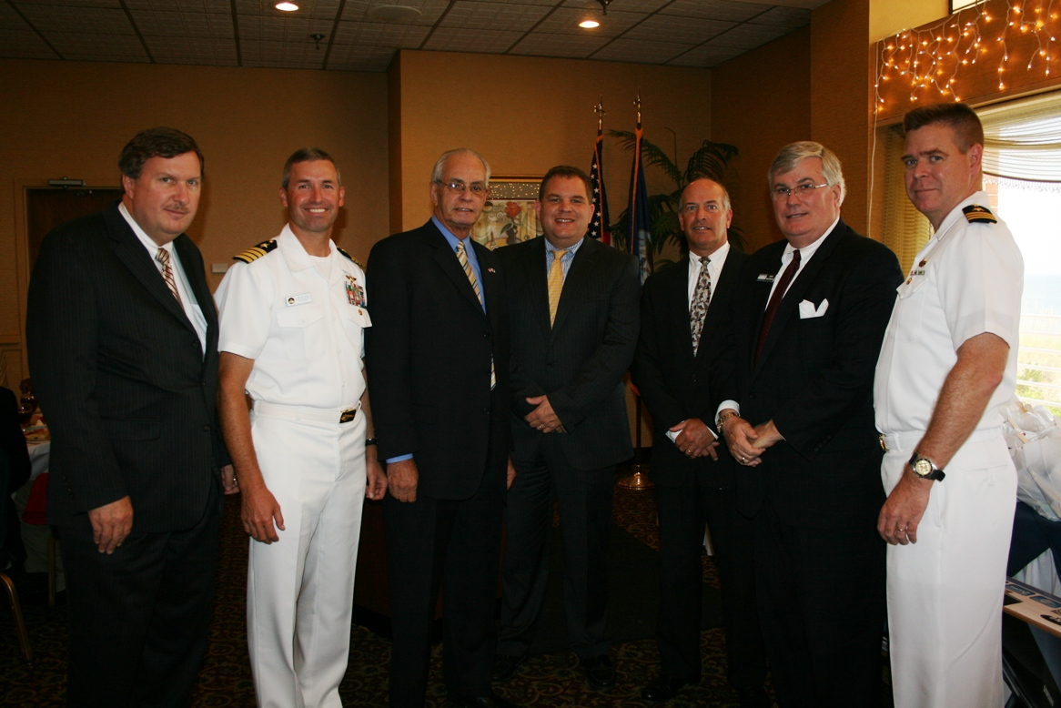 (from left) Ira Agricola, Senior Vice President, Hampton Roads Chamber of Commerce; Captain James Webb, USN, Executive Officer, NAS Oceana; Joseph Licari, Vice President, USA Discounters; Jim Wood, Virginia Beach City Councilman; John Wilson, Chair, Virginia Beach Division, Hampton Roads Chamber of Commerce; Jack Hornbeck, CCE, President & CEO, Hampton Roads Chamber of Commerce; and Cdr. Michael Dewitt, Executive Officer JEB-Little Creek-Fort Story.  Photo courtesy of the Hampton Roads Chamber of Commerce