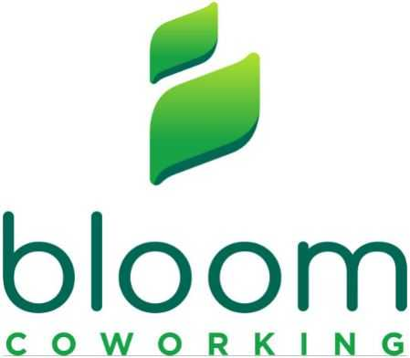 Bloom Coworking Celebrating With Ribbon Cutting