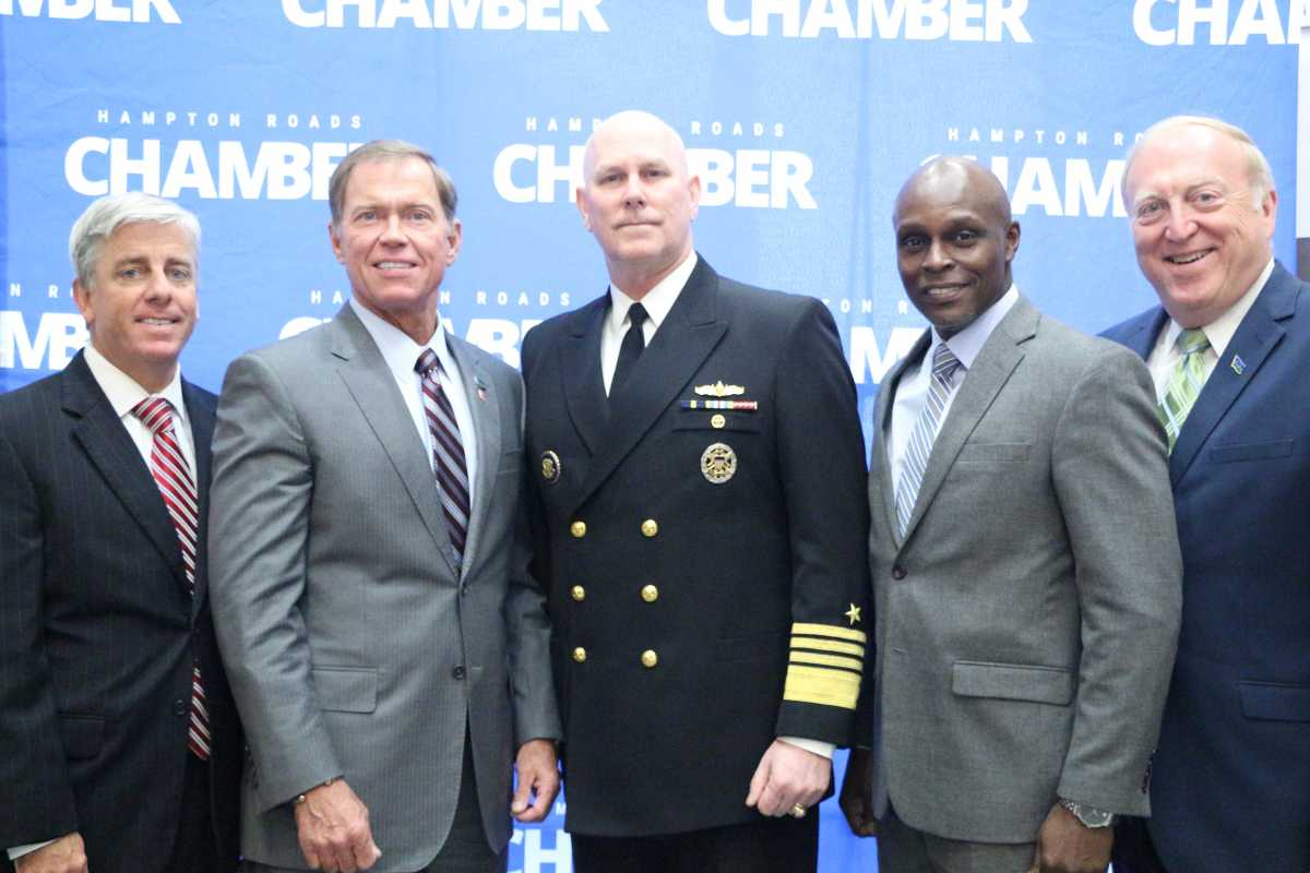 Admiral Christopher W. Grady addresses the business community