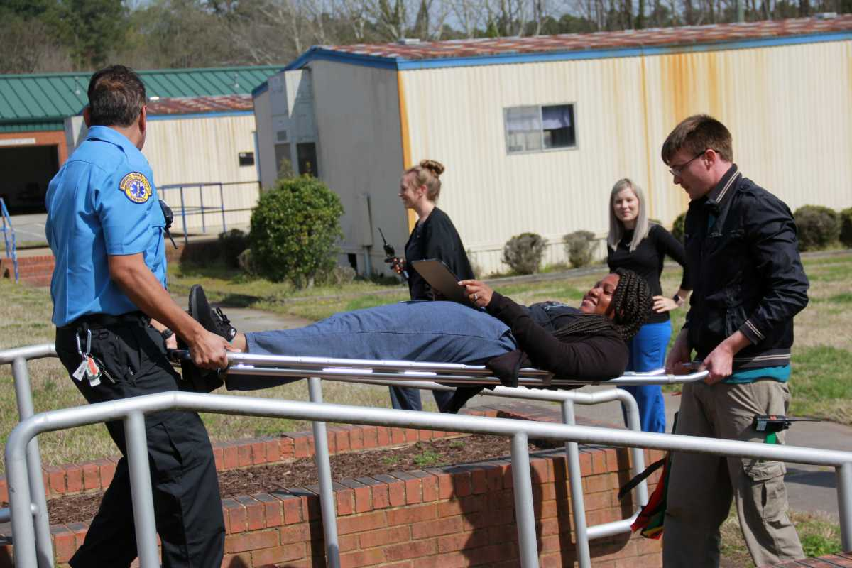 Drill helps Paul D. Camp Community College nursing and allied health students handle emergency in a lifelike setting